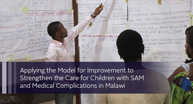 Applying the Model for Improvement to  Strengthen the Care for Children with SAM  and Medical Complications in Malawi. Photo of someone indicating a wall writing to a group