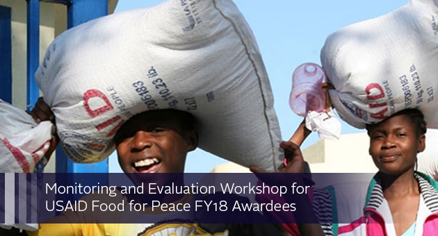 Monitoring and Evaluation Workshop for USAID Food for Peace FY18 Awardees. photo of women carrying sacks of supplies