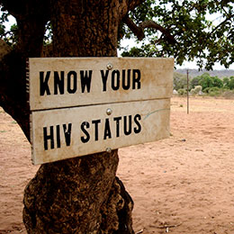 "© 2010 Jon Rawlinson. Photo of a sign ""Know your HIV status."""