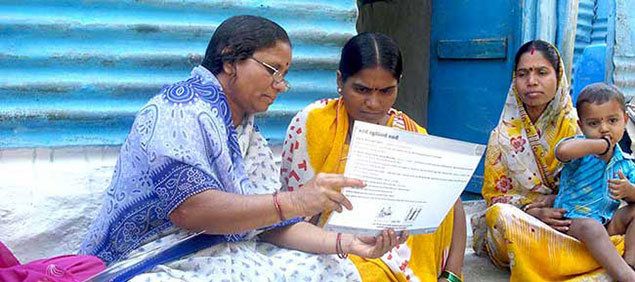 © 2009 Hanmanta V. Wadgave, Courtesy of Photoshare. A self-help group (SHG) member provides a mother with information on infant and newborn care during a home visit in India.