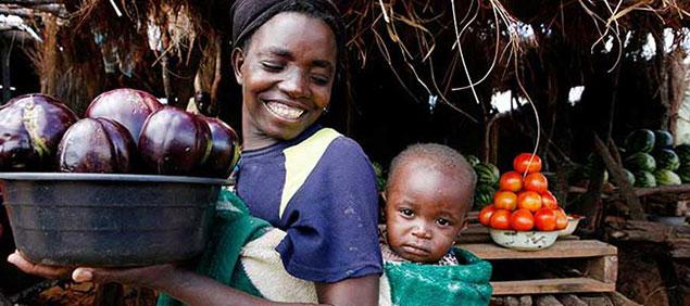 © 2010 Jessica Scranton, FHI 360. Mother and child in a market in Zambia.