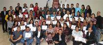 Course participants gather to receive certificates.