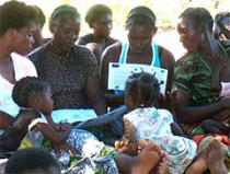 women with children viewing materials