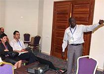 photo of Gad Tukamushaba presenting