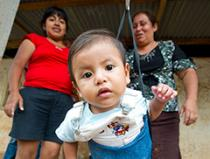 a baby gets weighed in Guatemala