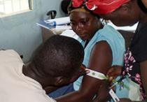 woman having her arm measured at a clinic