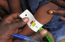 child's arm being measured with measuring tape