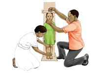two adults measure a child's height