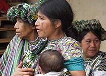 Three women in Guatemala with a baby