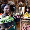 © 2010 Jessica Scranton, FHI 360. Woman in a Zambian market with a diverse variety of fruits and vegetables.