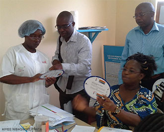 Health workers using new BMI wheels. (Photo by Aimee Nibagwire)