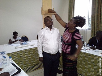 Participants at the Côte d'Ivoire training use a height board during a microteaching session. (Photo by Aimee Nibagwire)