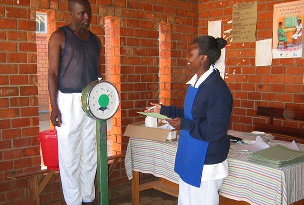 A client is weighed at a clinic.
